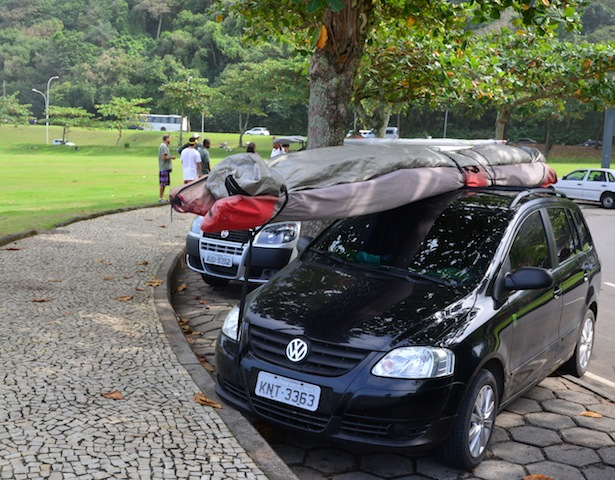 The weather was unfavorable for hang gliding. Tour companies with hang gliders on top of their cars waiting for better weather and customers.