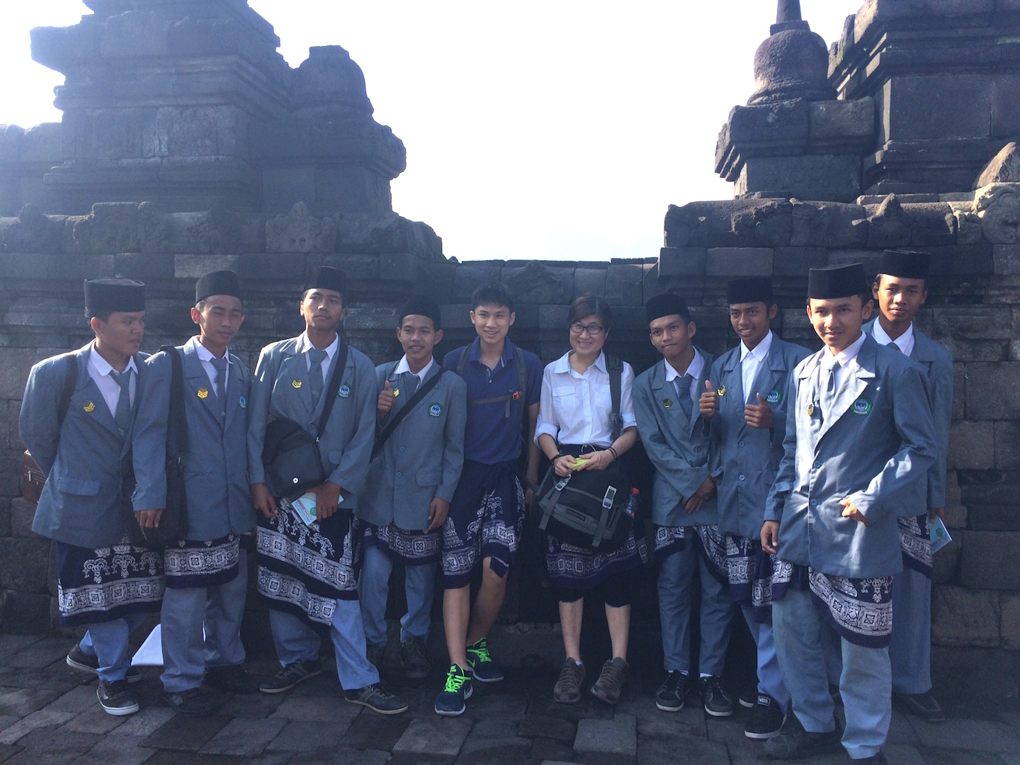My son and I with a group of Indonesian students in Borobodur Indonesia