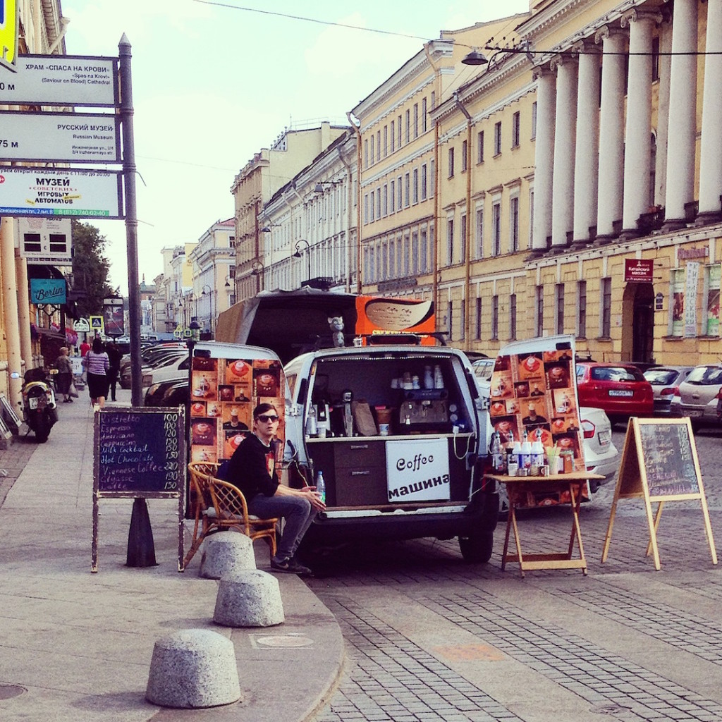 Young man selling coffee in St. Petersburg Russia.