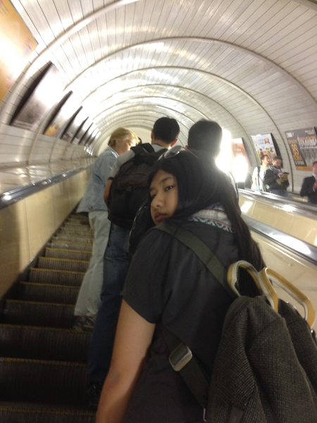 Taking the metro's escalator at the end of the tour with Maria the tour guide.