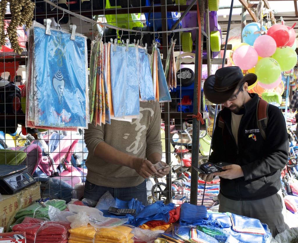 Erik buying Mongolian scarves