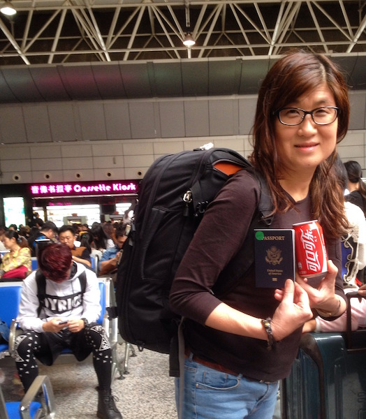 Me waiting to board the train celebrating with a complimentary Coke from Frasers Suite Guangzhou