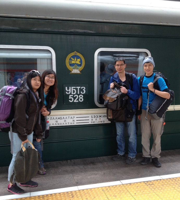 The family arriving in Beijing on the Trans Mongolian train