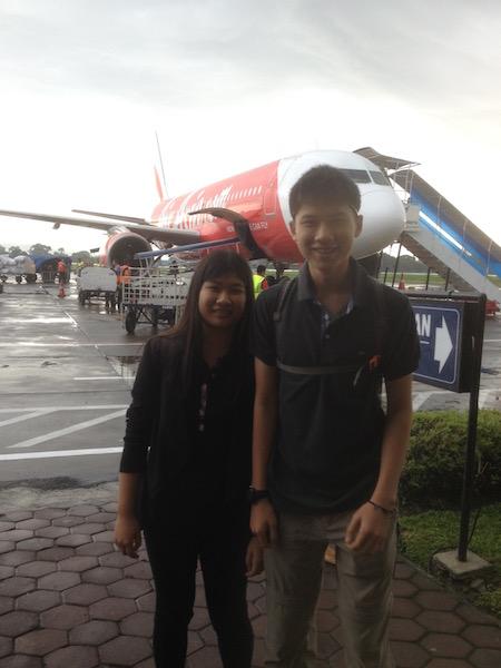 Teens arriving in the rain at Yogjakarta