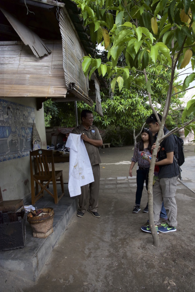 Andres showing the process of making a batik