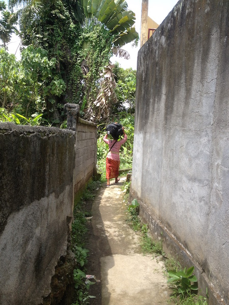 This is the path to the villa. Photo shows Wayan, the caretaker carrying my luggage on her head.
