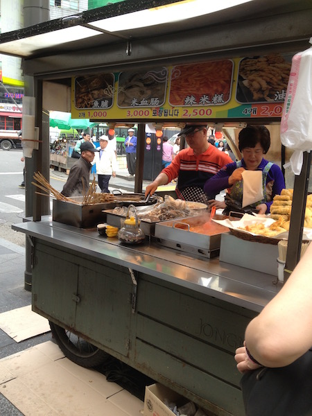 Husband and wife team selling a variety of street foods including twigim