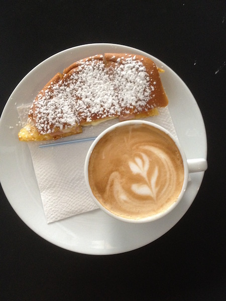 Latte and mallorca at Aroma Coffee Shop
