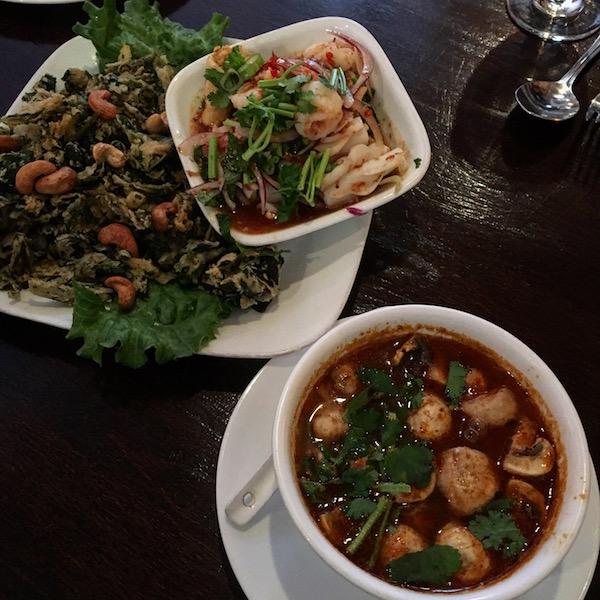 Tom yam and Thai crispy watercress salad at Sripraphai Thai Restaurant